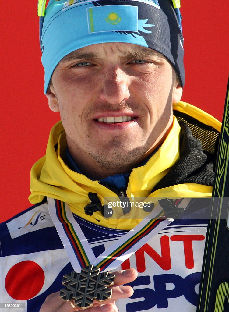 Kazakhstan's Alexey Poltoranin poses on March 3, 2013 with his Bronze medal pn the podium of the Men's Cross Country skiing 50 Km Classic Mass Start of the FIS Nordic World Ski Championships at Val Di Fiemme Cross Country stadium in Cavalese, northern Italy. AFP PHOTO / PIERRE TEYSSOT