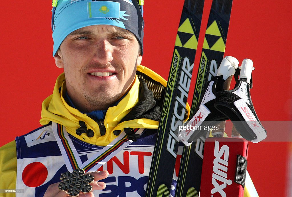 Kazakhstan's Alexey Poltoranin poses with his bronze medal at the Men's Cross Country skiing 50 Km Classic Mass Start of the FIS Nordic World Ski Championships at Val Di Fiemme Cross Country stadium in Cavalese, northern Italy on March 3, 2013.