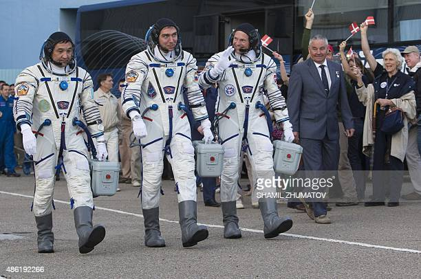 Kazakhstan's cosmonaut Aydyn Aimbetov Russian cosmonaut Sergei Volkov Denmark's astronaut Andreas Mogensen from the European Space Agency walk after...