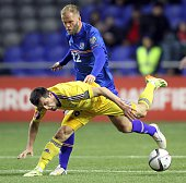Kazakhstan's defender Gafurzhan Suyumbayev vies for the ball with Iceland's forward Eidur Gudjohnsen during the Euro 2016 qualifying football match...
