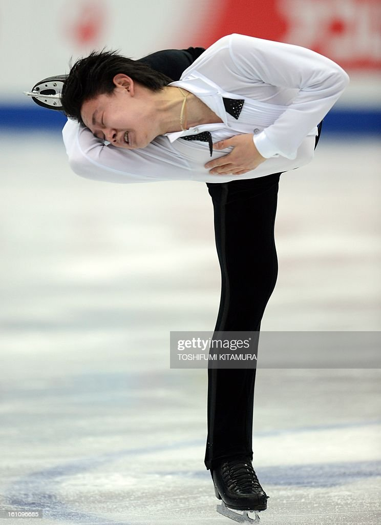 Kazakhstan's Denis Ten performs his free skating in the men's event during the Four Continents figure skating championships in Osaka on February 9, 2013.