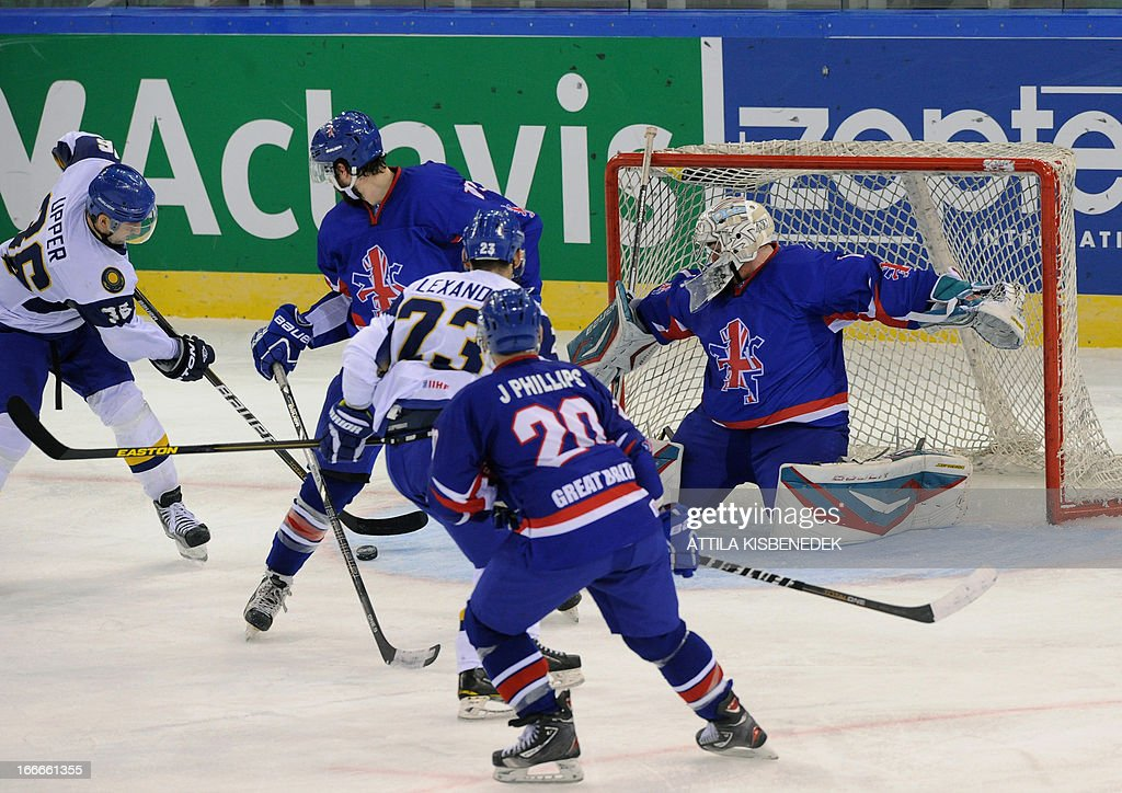 Kazakhstan's Dmitry Upper (L) vies with Great Britain's players during a 2013 IIHF Ice Hockey World Championship Division I Group A match between their teams in 'Papp Laszlo' Arena of Budapest on April 15, 2013.