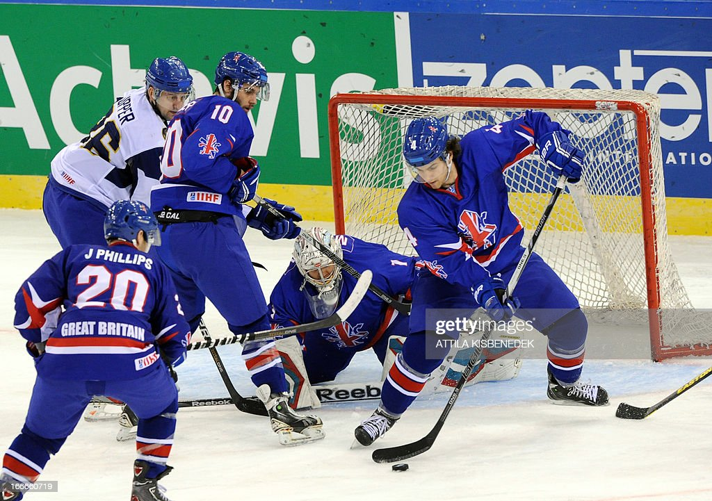 Kazakhstan's Dmitry Upper (L) vies with Great Britain's Robert Farmer (3rd L) Jonathan Phillips (front), goalkeeper Stephen Murphy (C) and Stephen Lee (R) during a 2013 IIHF Ice Hockey World Championship Division I Group A match between their teams in 'Papp Laszlo' Arena of Budapest on April 15, 2013.