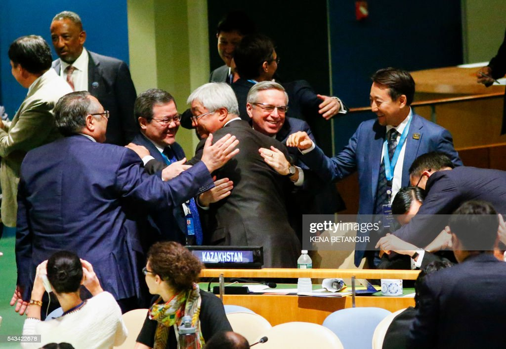 Kazakhstan's Foreign Minister Erlan Idrissov (C) reacts after Kazakhstan won a seat during the Election of five non-permanent members of the Security Council at the United Nations in New York on June 28 2016. Three European countries and two Asian nations are battling for seats on the UN Security Council in elections that are drawing attention to the refugee crisis and human rights. / AFP / KENA