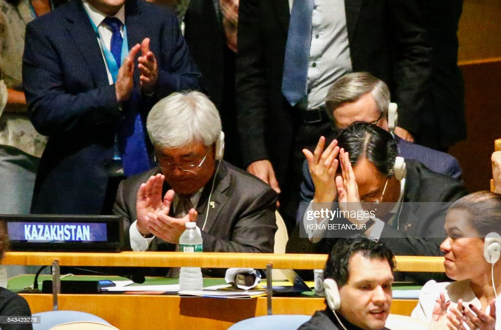 Kazakhstan's Foreign Minister Erlan Idrissov (L) reacts after Kazakhstan won a seat during the Election of five non-permanent members of the Security Council at the United Nations in New York on June 28 2016. Three European countries and two Asian nations are battling for seats on the UN Security Council in elections that are drawing attention to the refugee crisis and human rights. / AFP / KENA