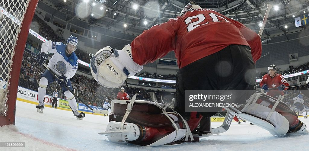 Kazakhstan's forward Yevgeni Rymarev scores past Switzerland's goalie Reto Berra during a IIHF International Ice Hockey World Championship...