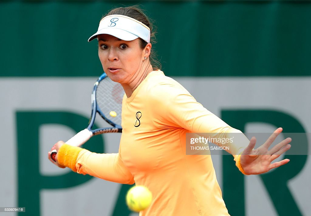 Kazakhstan's Galina Voskoboeva returns the ball to China's Shuai Zhang during their women's first round match at the Roland Garros 2016 French Tennis Open in Paris on May 24, 2016. / AFP / THOMAS