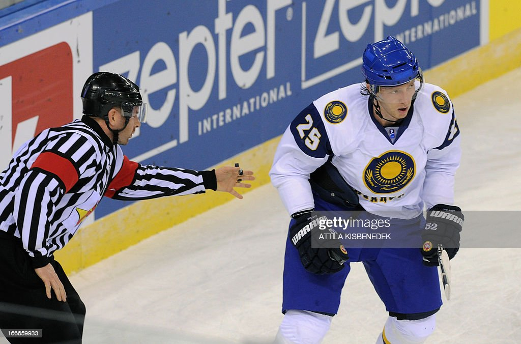 Kazakhstan's Ilya Solarev (R) celebrates scoring against Great Britain during a 2013 IIHF Ice Hockey World Championship Division I Group A match between their teams in 'Papp Laszlo' Arena of Budapest on April 15, 2013. AFP PHOTO / ATTILA KISBENEDEK
