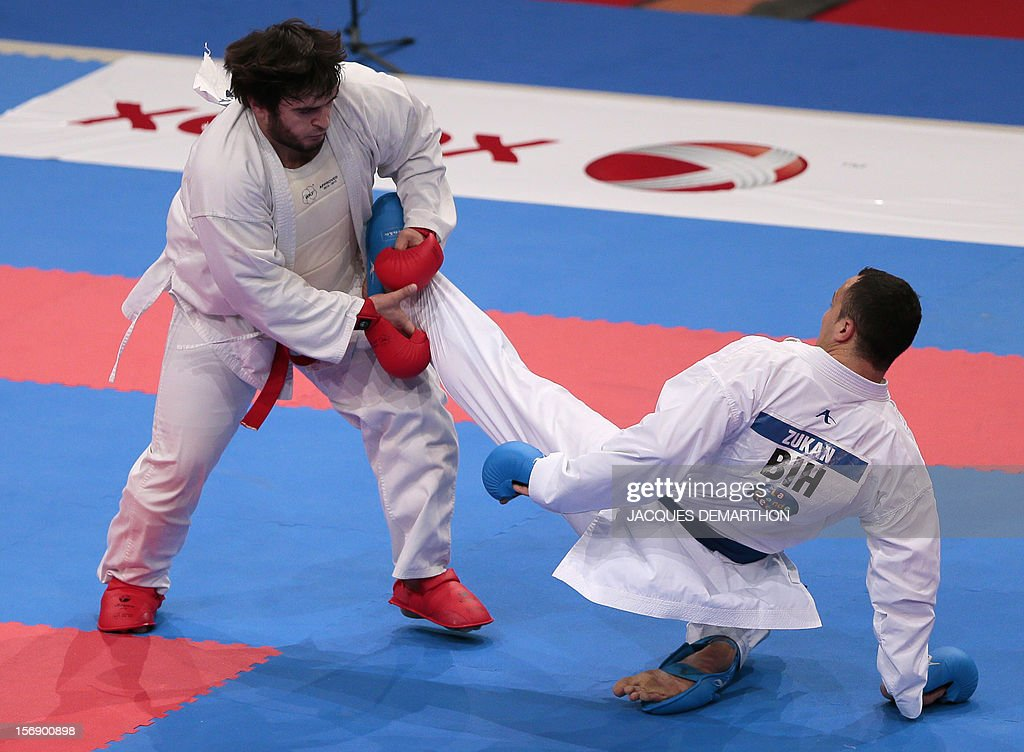 Kazakhstan's Khalid Khalidov (L) fights against Bosnia-Herzegovinia's Admir Zukan (R) during their men's bronze medal bout in the over 84 kg category at the Karate world championships on November 24, 2012 in Paris. Khalidov won the bout.