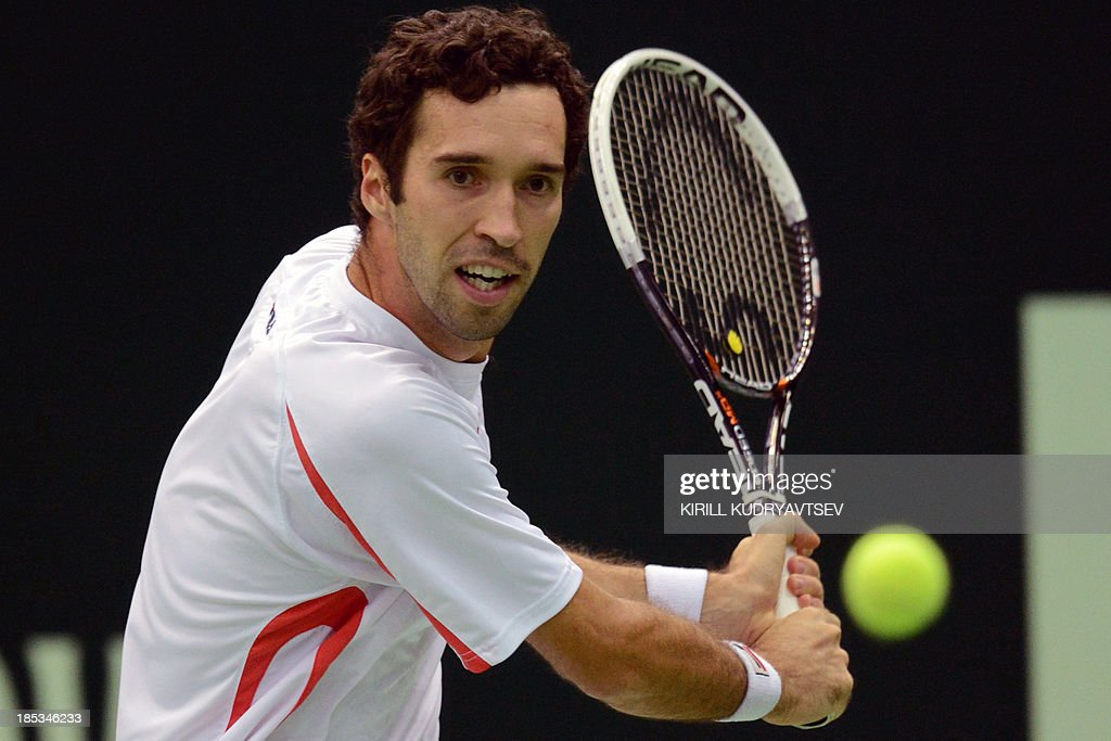 Kazakhstan's Mikhail Kukushkin returns a ball to Italy's Andreas Seppi during the Kremlin Cup tennis tournament semifinal match in Moscow on October 19, 2013.