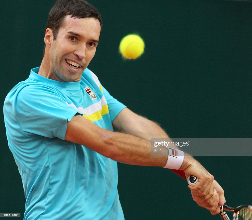 Kazakhstan's Mikhail Kukushkin returns a shot against Czech Jan Hajek during their Davis Cup quarterfinal in the Kazakh capital Astana, on April 5, 2013. What looked like being a fairly straightforward assignment in Kazakhstan for Davis Cup holders the Czech Republic has turned into a quarter-final minefield following the late withdrawal of top player Tomas Berdych.
