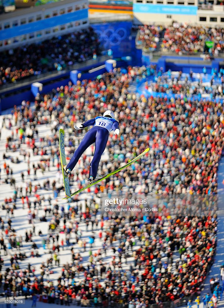 Kazakhstan's Nikolay Karpenko above the crowd during the qualification round for the long hill individual ski jumping at Whistler Olympic Park on day...