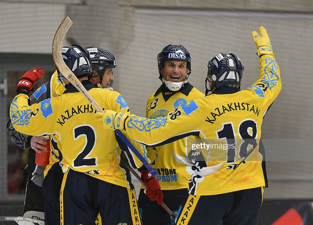 Kazakhstan's players celebrate after winning the bronze medal match Finland vs Kazakhstan with 3-6 at the Bandy World Championship in Vanersborg, Sweden on February 3, 2013.