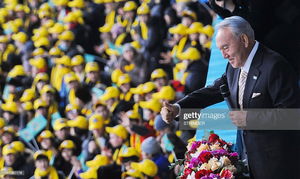 Kazakhstan's President Nursultan Nazarbayev (R) gestures as he takes part in celebrations of the Day of the First President at Astana stadium on December 1, 2012. Kazakhstan celebrates a new national holiday to honour first president Nursultan Nazarbayev, who has ruled the Central Asian state since the 1991 Soviet collapse, amid opposition complaints of a crackdown on dissent. AFP PHOTO / STRINGER