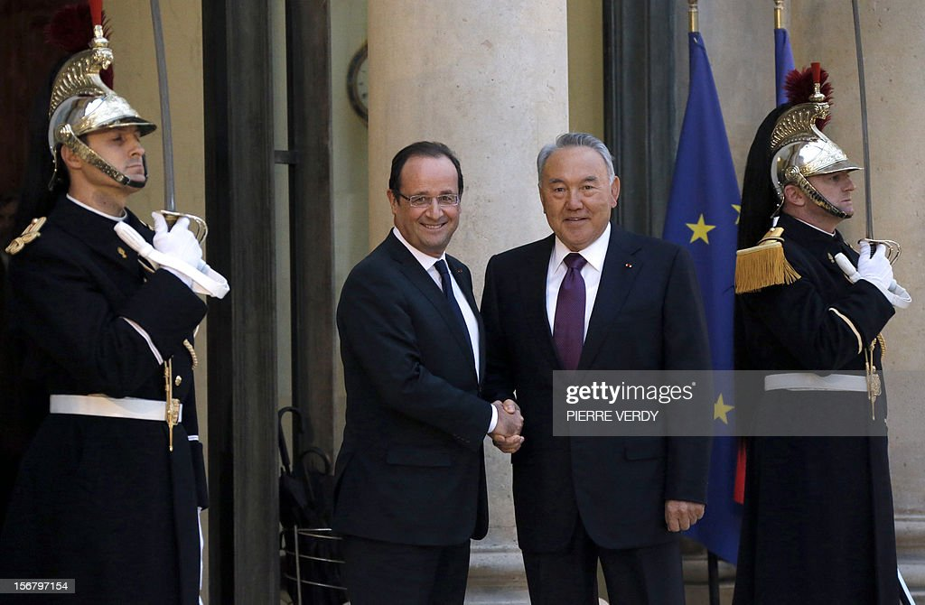 Kazakhstan's President Nursultan Nazarbayev (R) shakes hands with his French counterpart Francois Hollande as he arrives on November 21, 2012 at the Elysee Palace in Paris. AFP PHOTO PIERRE VERDY