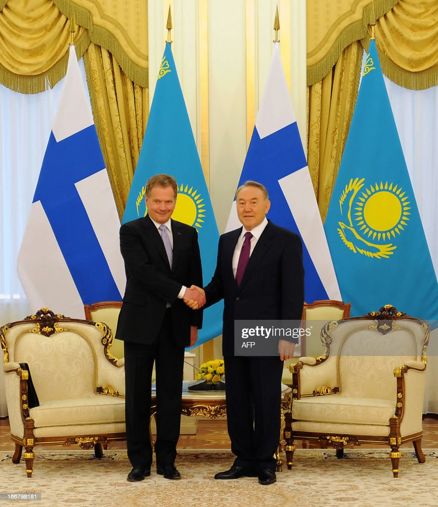 Kazakhstan's President Nursultan Nazarbayev (R) shakes hands with his Finland's counterpart Sauli Niinisto during their meeting in the Kazakh capital Astana, on April 17, 2013. Finland's President is on an official visit to the Central Asia's nation of Kazakhstan.