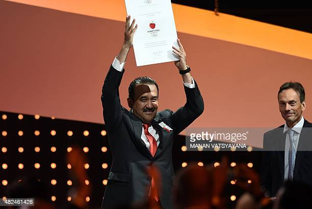 Kazakhstan's Prime Minister Karim Massimov poses with the diploma after their bid presentation to host the 2022 Winter Olympics in the Kazakh city of...