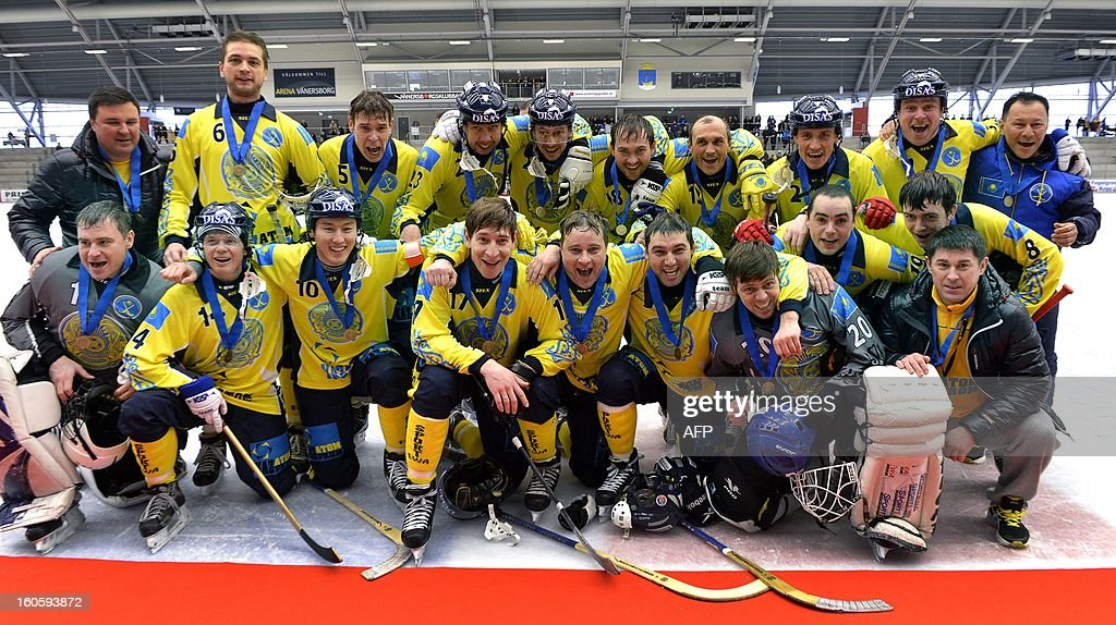 Kazakhstan's team celebrates after winning the bronze medal match Finland vs Kazakhstan with 3-6 at the Bandy World Championship in Vanersborg, Sweden on February 3, 2013.