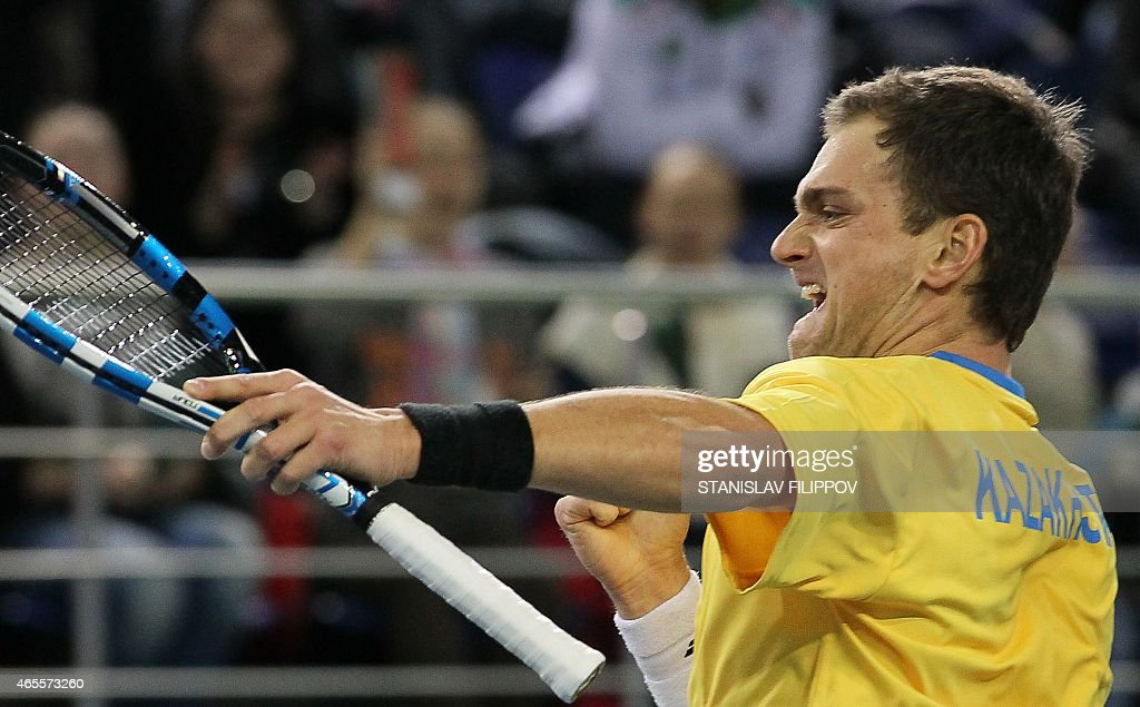Kazakhstans tennis player Alexander Nedovyesov reacts during the Davis Cup World Group first round single tennis match against Italys tennis player Fabio Fognini in Astana on March 8, 2015.