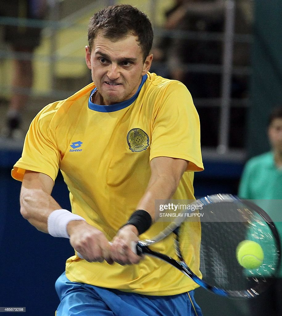 Kazakhstans tennis player Alexander Nedovyesov returns the ball to Italys tennis player Fabio Fognini during their Davis Cup World Group first round single tennis match in Astana on March 8, 2015.