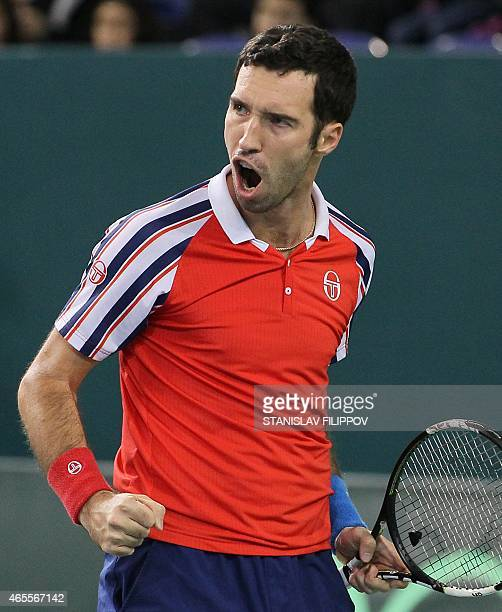 Kazakhstans tennis player Mikhail Kukushkin reacts during the Davis Cup World Group first round single tennis match against Italys tennis player...