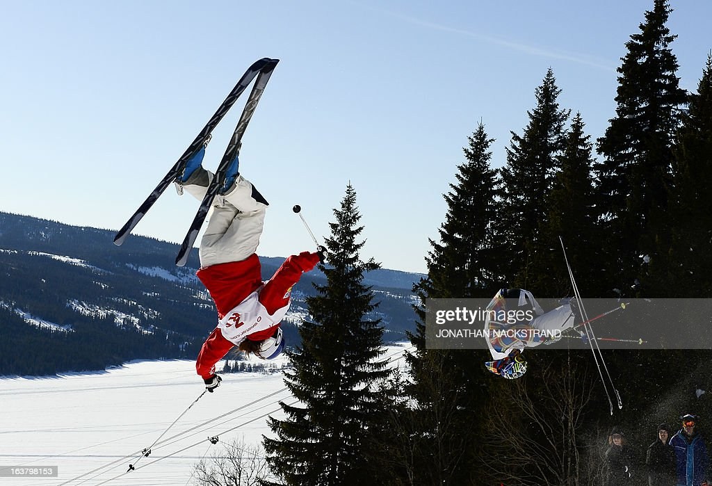 Kazakhstan's Yulia Galysheva (R) competes against Heather Mcphie of the US during the women's Dual Moguls event of the FIS Freestyle World Cup in Are, Sweden, on March 16, 2013.