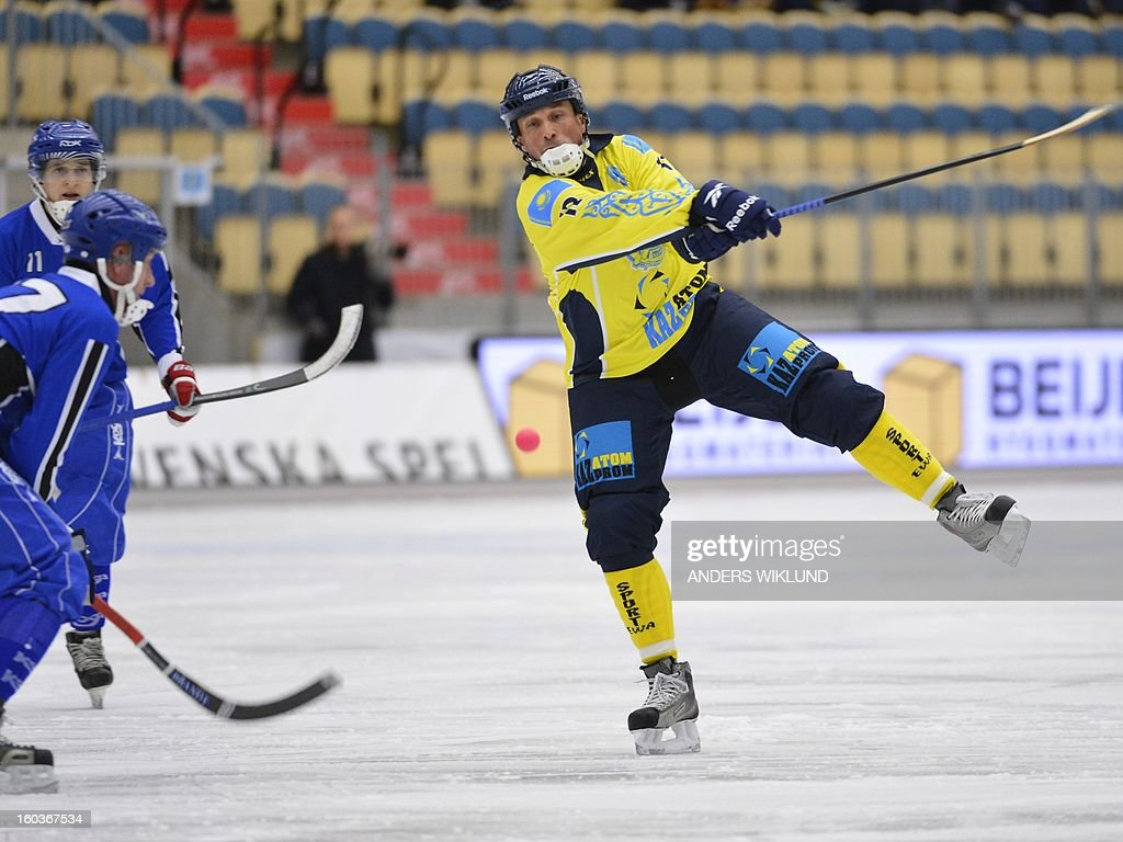 Kazakhstan's Yuriy Loginov (R) plays the ball during the Bandy World Championship match Finland vs Kazakhstan in Vanersborg January 30, 2013.