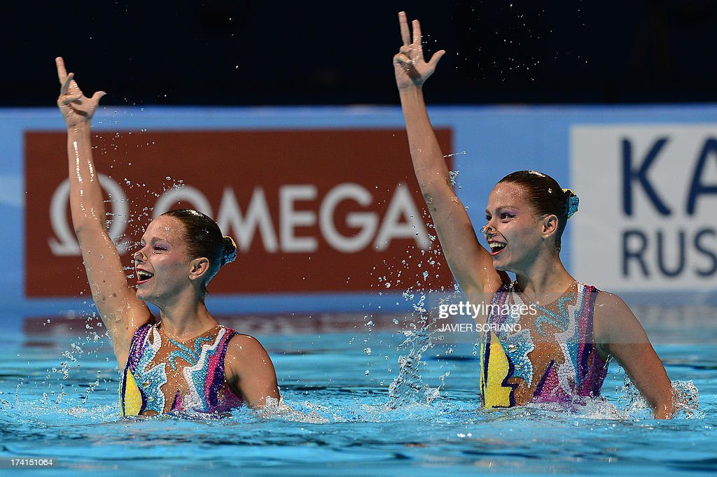Kazakstan's Alexandra Nemich and Yekaterina Nemich compete in the duet technique preliminary round during the synchronised swimming competition in the FINA World Championships at the Palau Sant Jordi in Barcelona, on July 21, 2013.