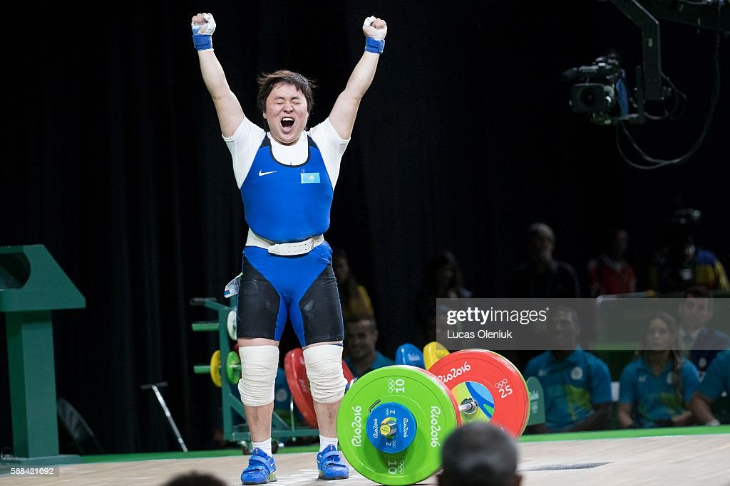 Kazakstan's Zhazira Zhapparkul cheers after lifting 144kg's in the clean and jerk portion of the women's 69kg weightlifting competition at the 2016...