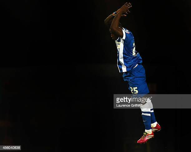 Kazenga Lua Lua of Brighton and Hove Albion jumps for joy as he scores the second goal during the Capital One Third Round match between Burton Albion...