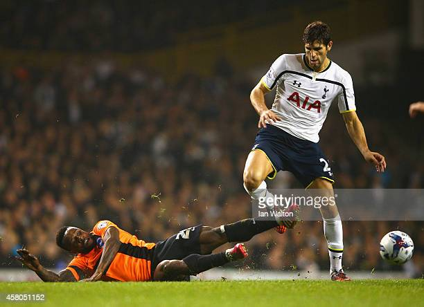 Kazenga LuaLua of Brighton and Federico Fazio of Spurs during the Capital One Cup Fourth Round match Tottenham Hotspur and Brighton Hove Albion at...