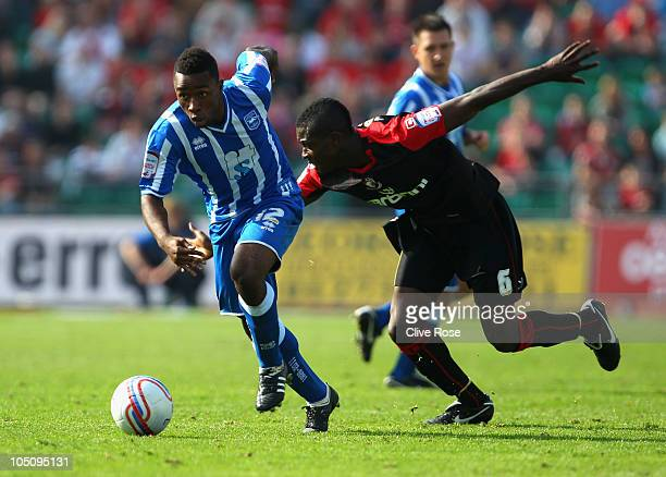 Kazenga LuaLua of Brighton Hove Albion is challenged by Marvin Bartley of Bournemouth during the npower League One match between Brighton Hove Albion...