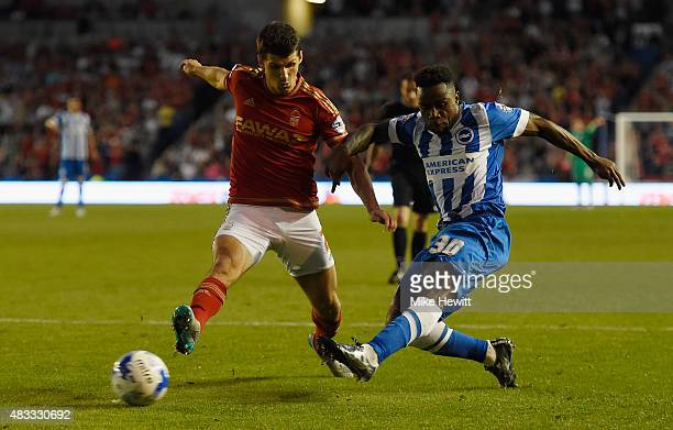 Kazenga LuaLua of Brighton scores the first goal of the seaso despite the efforts of Eric Lichaj of Nottingham Forest during the Sky Bet Championship...