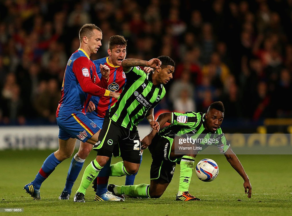 Kazenga LuuLua and Liam Bridcutt of Brighton & HOve Albion team up to get the ball during the npower Championship play off semi final first leg at Selhurst Park on May 10, 2013 in London, England.