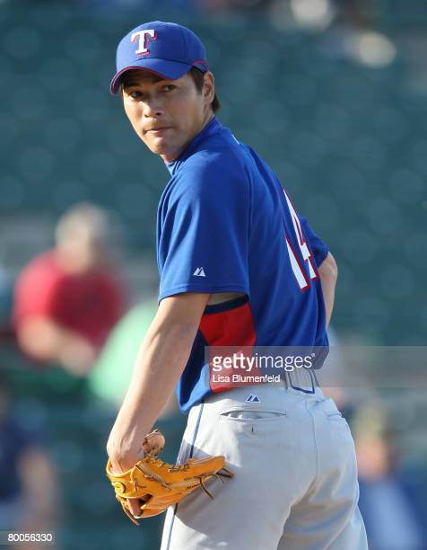 Kazou Fukumori of the Texas Rangers looks back to first base during the game against the Los Angeles Angels of Anaheim at Tempe Diablo Stadium on...