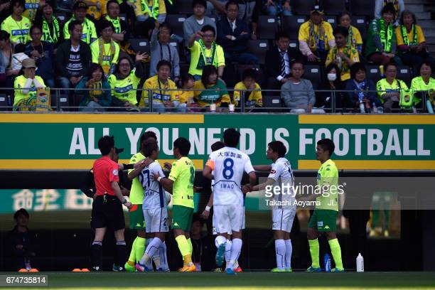 Kazuaki Mawatari of Tokushima Vortis receives a red card by referee Hiroyoshi Takayama after throwing the ball and pushing a ball boy during the...