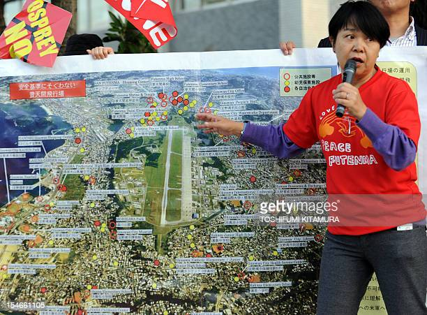 Kazue Tamamoto a city council member from Ginowan city Okinawa explains the situation at the US Futenma military base during their protest rally...