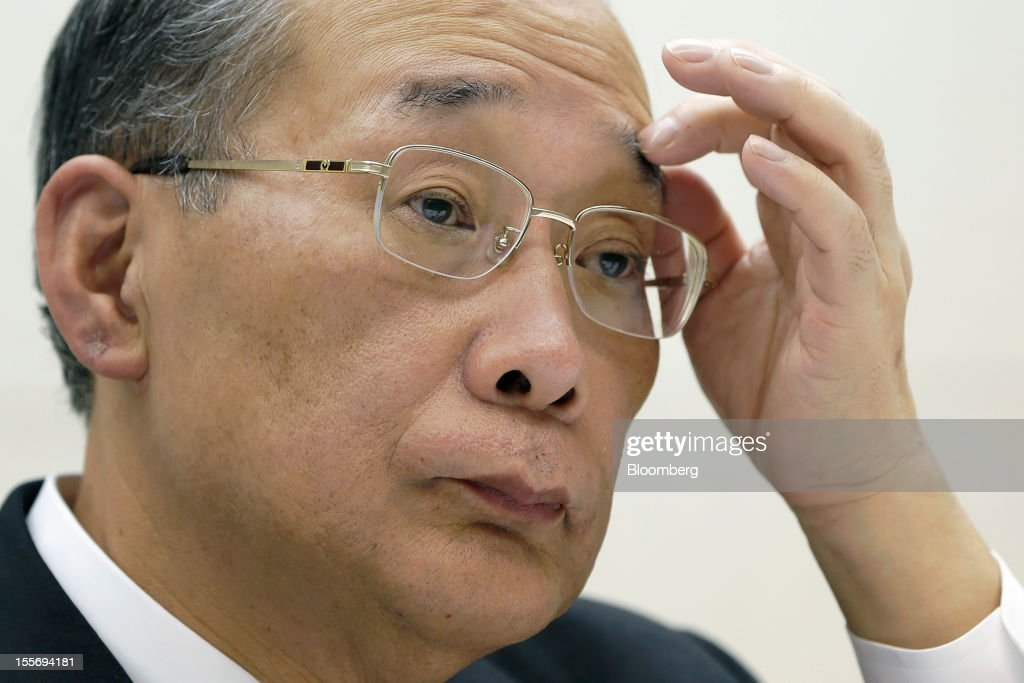 Kazuhiko Shimokobe, chairman of Tokyo Electric Power Co. (Tepco), attends a news conference at the company's headquarters in Tokyo, Japan, on Wednesday, Nov. 7, 2012. Tepco may ask the government for more funds to cover decontamination and reactor decommissioning costs from last year's nuclear disaster at its Fukushima Dai-Ichi atomic plant. Photographer: Kiyoshi Ota/Bloomberg via Getty Images