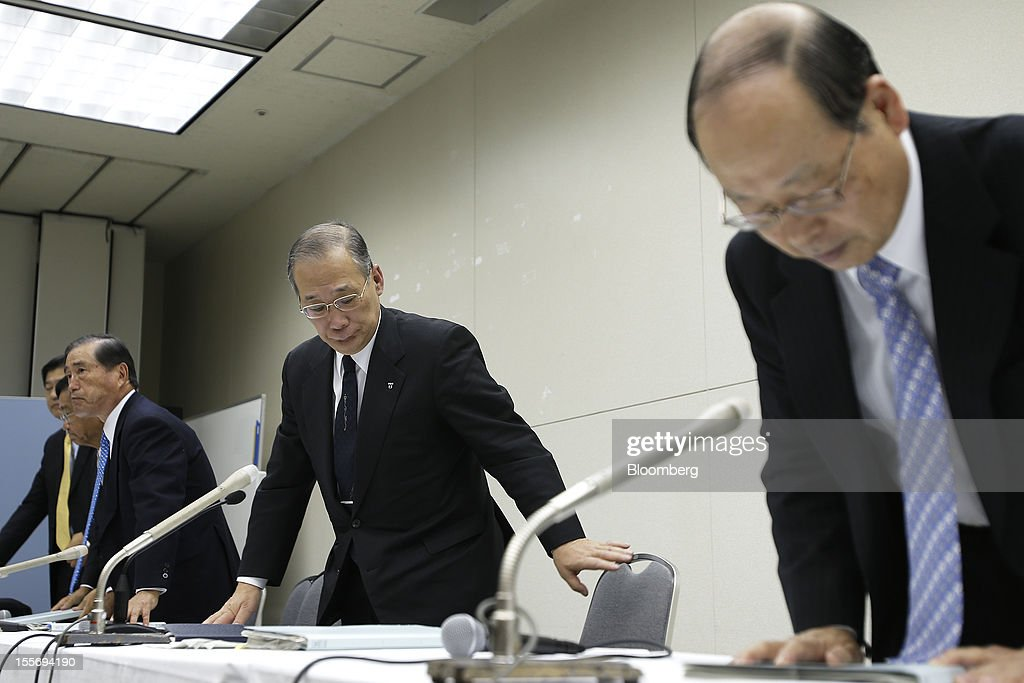 Kazuhiko Shimokobe, chairman of Tokyo Electric Power Co. (Tepco), center, leaves a news conference at the company's headquarters in Tokyo, Japan, on Wednesday, Nov. 7, 2012. Tepco may ask the government for more funds to cover decontamination and reactor decommissioning costs from last year's nuclear disaster at its Fukushima Dai-Ichi atomic plant. Photographer: Kiyoshi Ota/Bloomberg via Getty Images