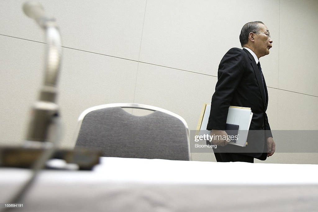 Kazuhiko Shimokobe, chairman of Tokyo Electric Power Co. (Tepco), leaves a news conference at the company's headquarters in Tokyo, Japan, on Wednesday, Nov. 7, 2012. Tepco may ask the government for more funds to cover decontamination and reactor decommissioning costs from last year's nuclear disaster at its Fukushima Dai-Ichi atomic plant. Photographer: Kiyoshi Ota/Bloomberg via Getty Images