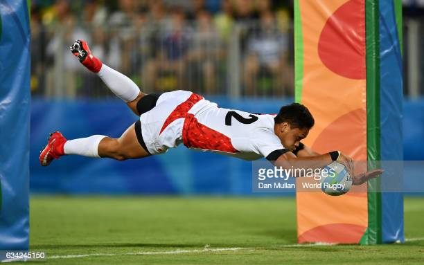Kazuhiro Goya of Japan dives over for a try during the Men's Rugby Sevens Bronze Medal match between Japan and South Africa on day six of the Rio...