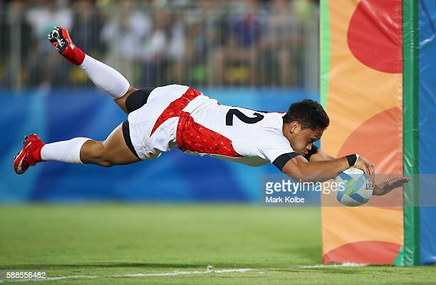Kazuhiro Goya of Japan dives to score a try during the Men's Rugby Sevens Bronze medal final match between Japan and South Africa on Day 6 of the Rio...