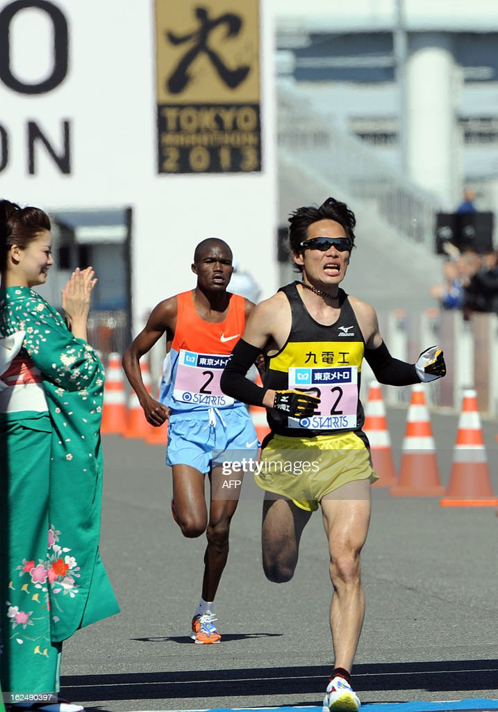 Kazuhiro Maeda (R) of Japan crosses the finish line of the Tokyo Marathon 2013 in Tokyo on February 24, 2013, while James Kwambai follows him. Maeda finished the fourth with a time of 2 hours 8 minutes, while Kwambai finished fifth with a time of 2 hours 8 minutes 02 seconds. AFP PHOTO / Rie ISHII