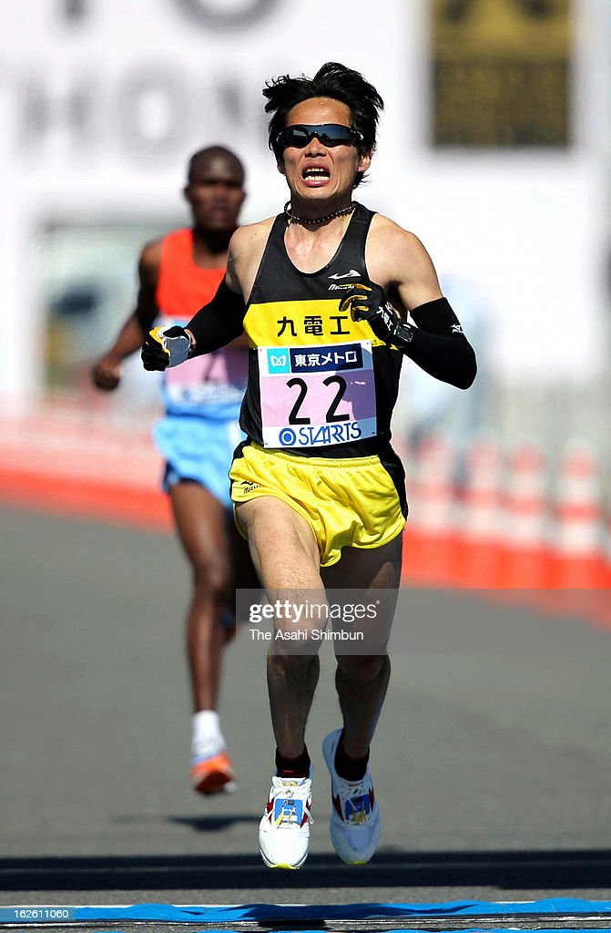 <a gi-track='captionPersonalityLinkClicked' href=/galleries/search?phrase=Kazuhiro+Maeda&family=editorial&specificpeople=4473744 ng-click='$event.stopPropagation()'>Kazuhiro Maeda</a> of Japan crosses the finishing line as he finishes fourth during the Tokyo Marathon 2013 at Tokyo Big Sight on February 24, 2013 in Tokyo, Japan.