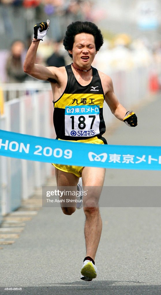 <a gi-track='captionPersonalityLinkClicked' href=/galleries/search?phrase=Kazuhiro+Maeda&family=editorial&specificpeople=4473744 ng-click='$event.stopPropagation()'>Kazuhiro Maeda</a> of Japan crosses the finishing tape to finish second during the 3rd Tokyo Marathon at Tokyo Big Sight on March 22, 2009 in Tokyo, Japan.