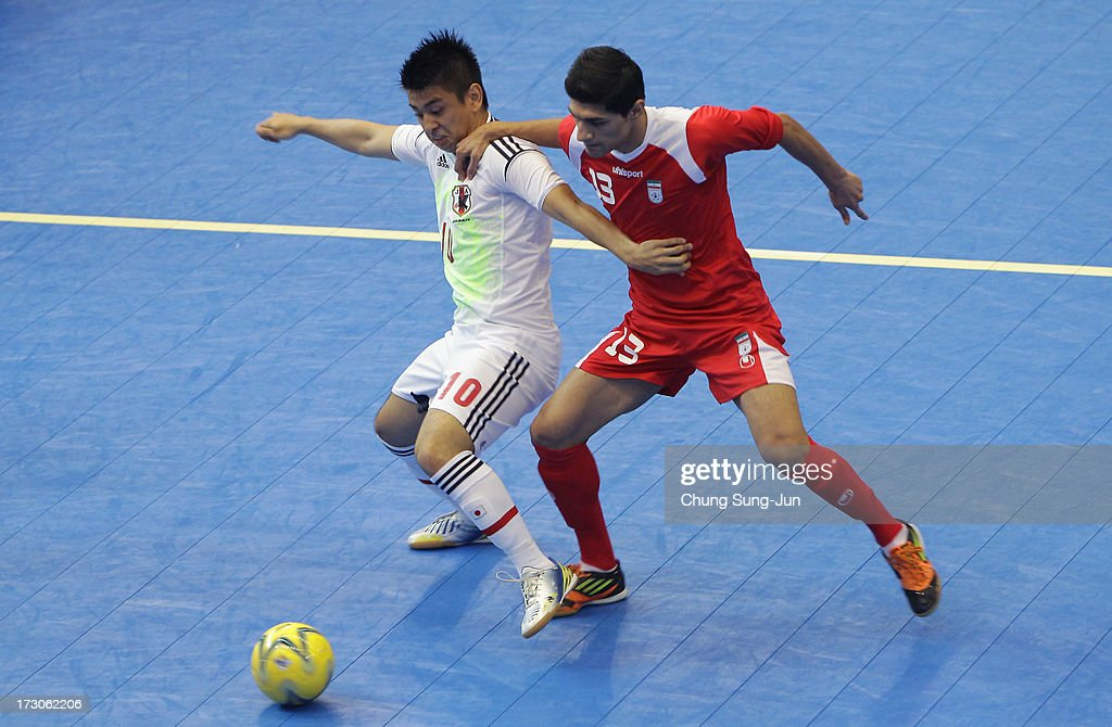 Kazuhiro Nibuya # 13 of Iran competes for the ball with Katsutoshi Henmi # 10 of Japan during the Men's Futsal Gold Medal match at Songdo Global University Campus Gymnasium during day eight of the 4th Asian Indoor & Martial Arts Games on July 6, 2013 in Incheon, South Korea.