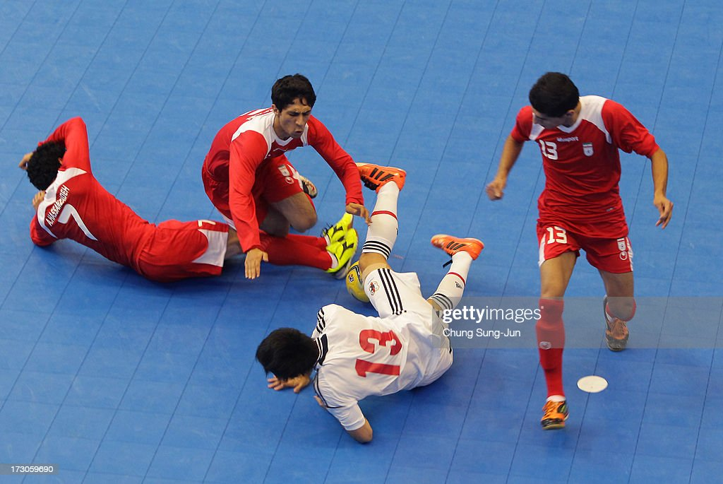 Kazuhiro Nibuya #13 of Japan compete for the ball with Alireza Vafaei #6 and Farhad Tavakoli # 13 of Iran during the Men's Futsal Gold Medal match at Songdo Global University Campus Gymnasium during day eight of the 4th Asian Indoor & Martial Arts Games on July 6, 2013 in Incheon, South Korea.