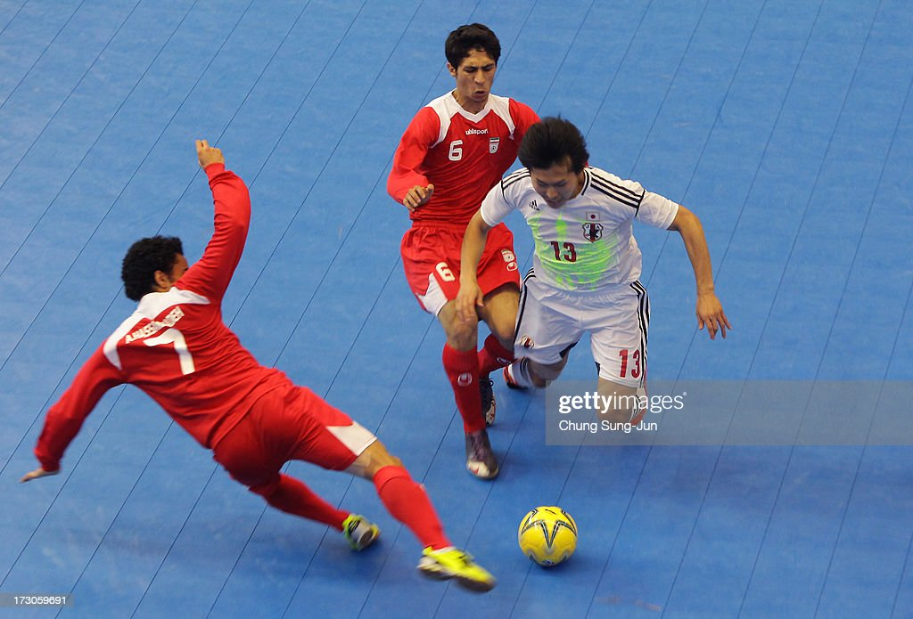 Kazuhiro Nibuya #13 of Japan compete for the ball with Alireza Vafaei #6 and Ali Asgher Hassan Zadeh Navlighe # 7 of Iran during the Men's Futsal Gold Medal match at Songdo Global University Campus Gymnasium during day eight of the 4th Asian Indoor & Martial Arts Games on July 6, 2013 in Incheon, South Korea.