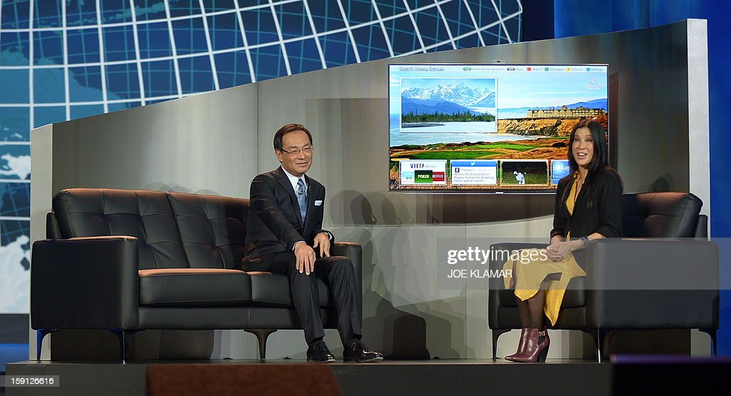 Kazuhiro Tsuga (L), President of Panasonic Corporation, and Chinese-American journalist, Lisa Ling (R), introduce personalized television viewing at the 2013 International Consumer Electronics Show in Las Vegas, Nevada, on January 8 ,2013. The annual CES which takes place from 8-11 January is a place where industry manufacturers, advertisers and tech-minded consumers converge to get a taste of new gadgets and innovations coming to the market each year.AFP PHOTO/JOE KLAMAR