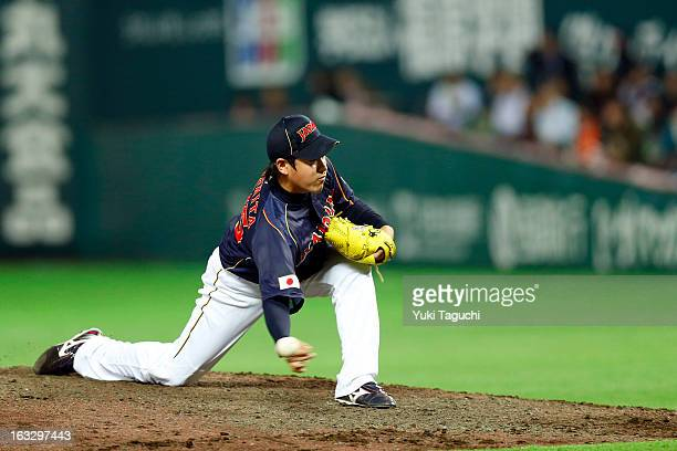 Kazuhisa Makita of Team Japan pitches during the 2013 World Baseball Classic exhibition game against the Yomiuri Giants at the Fukuoka Yahoo Japan...